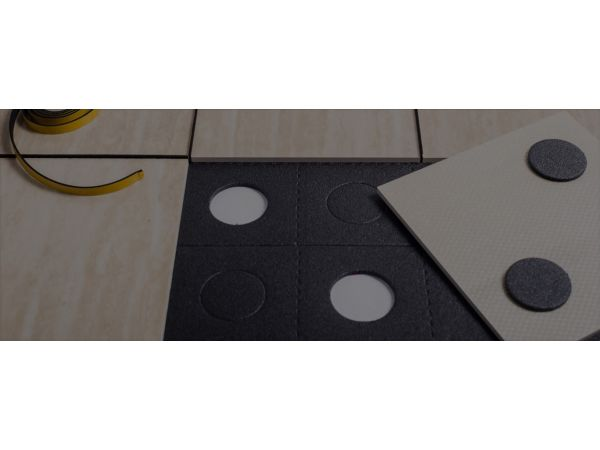 Building material system enabling tile reuse