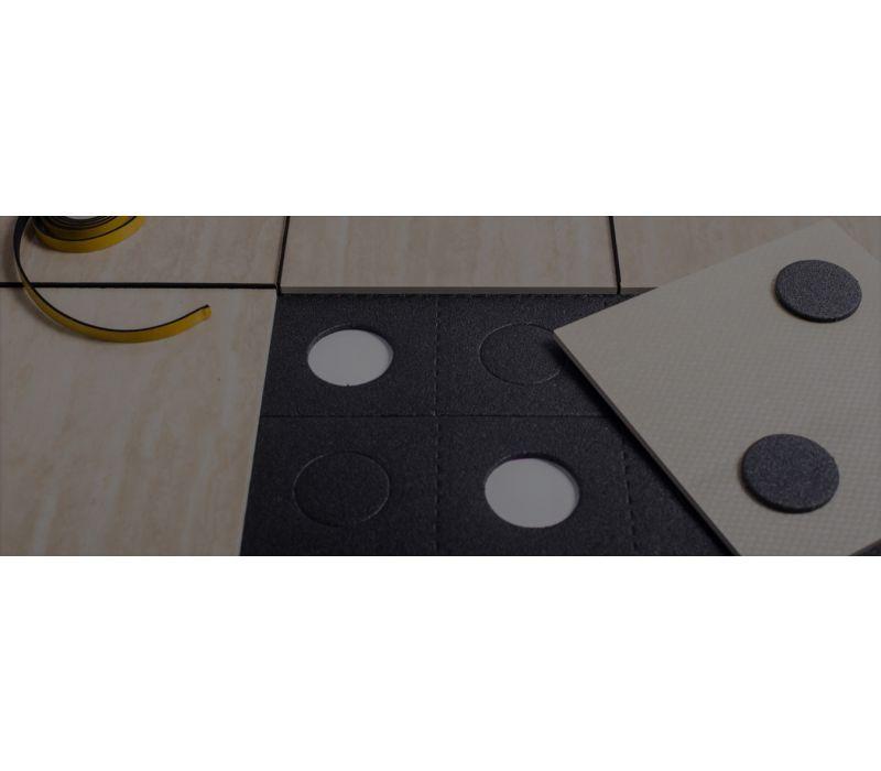 Building material system enabling tile reuse